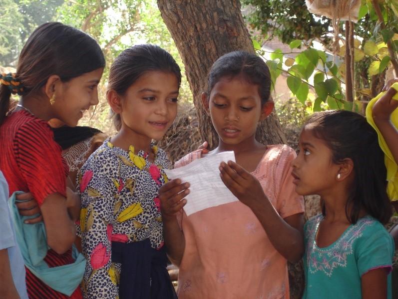Singing to lyrics written from TV, Khodi village, Gujarat
